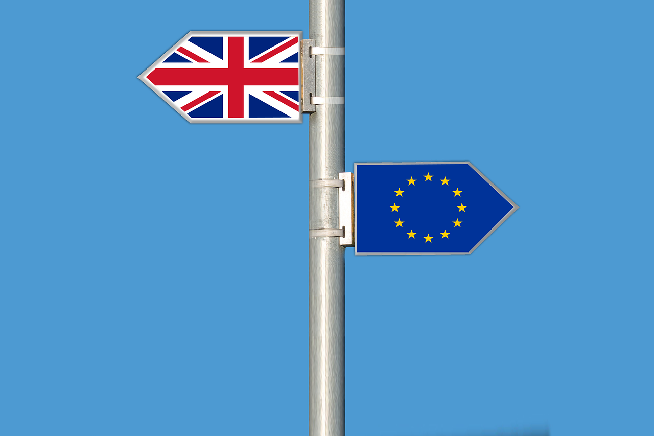 UK and EU flags on a signpost