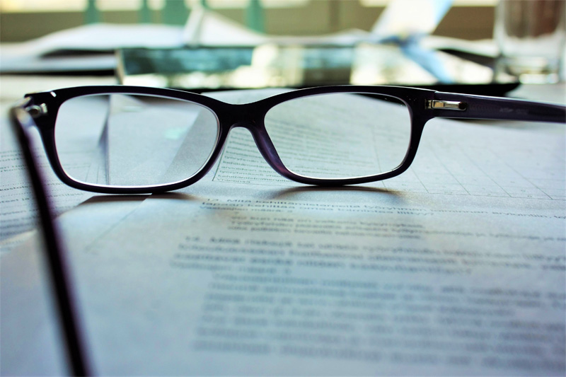 Pair of glasses on paperwork